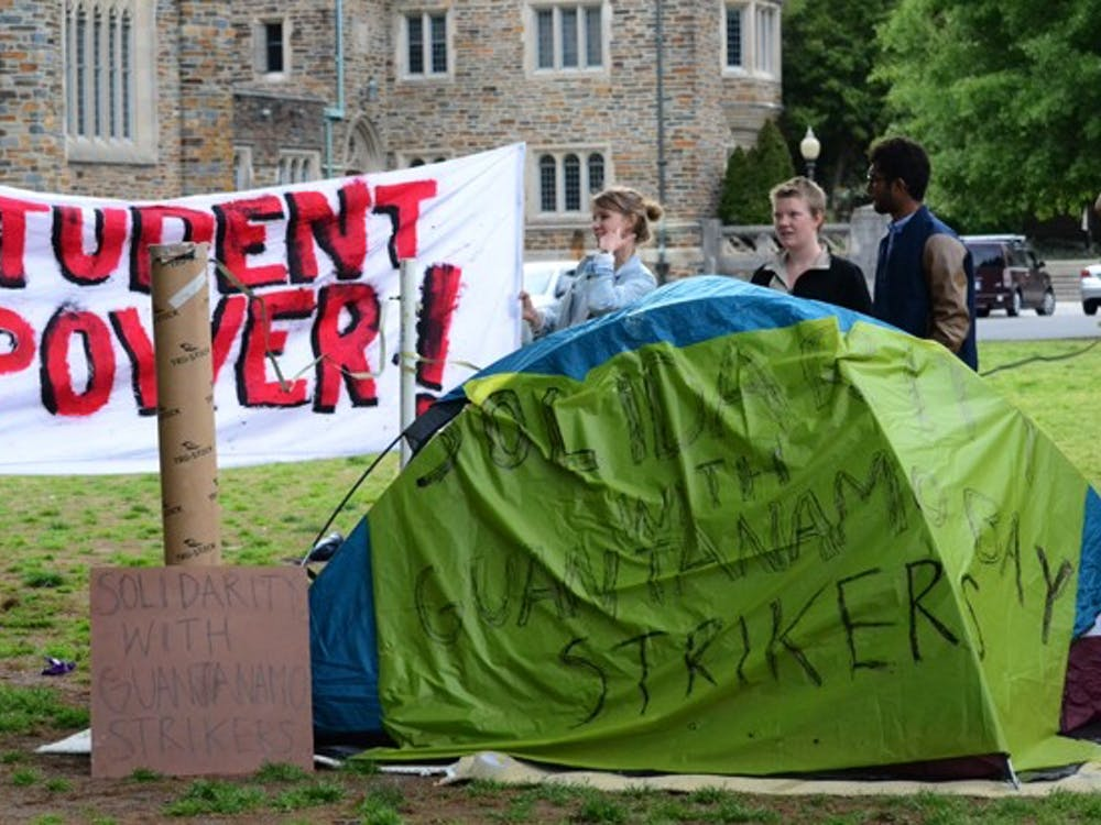 Students from Duke and UNC show support for a hunger strike among Guantanamo Bay prisoners on the Chapel Quad Monday. The protesters plan to occupy the quad indefinitely.