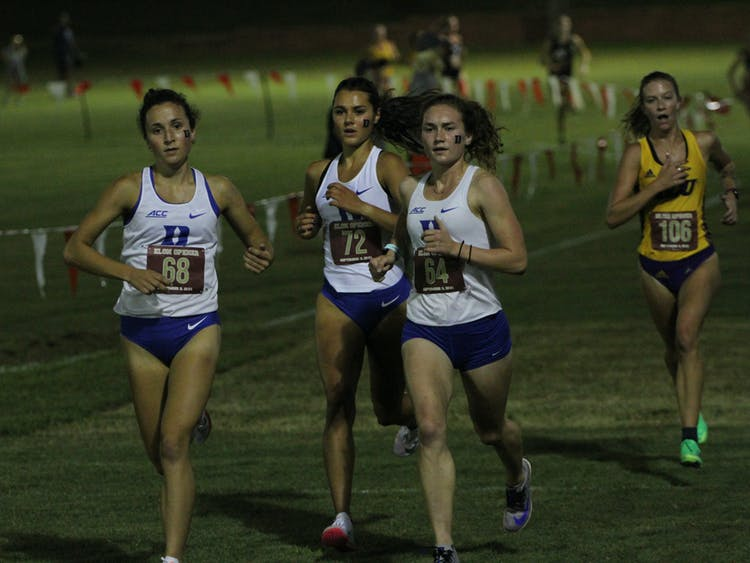 Sophomore Charlotte Tomkinson (center) finished 25th overall Friday.
