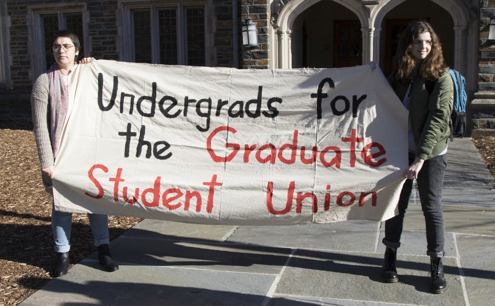 <p>Students delivered a statement to President Brodhead Tuesday&nbsp;about the University's recent decision to hire a law firm for union negotiations.&nbsp;</p>