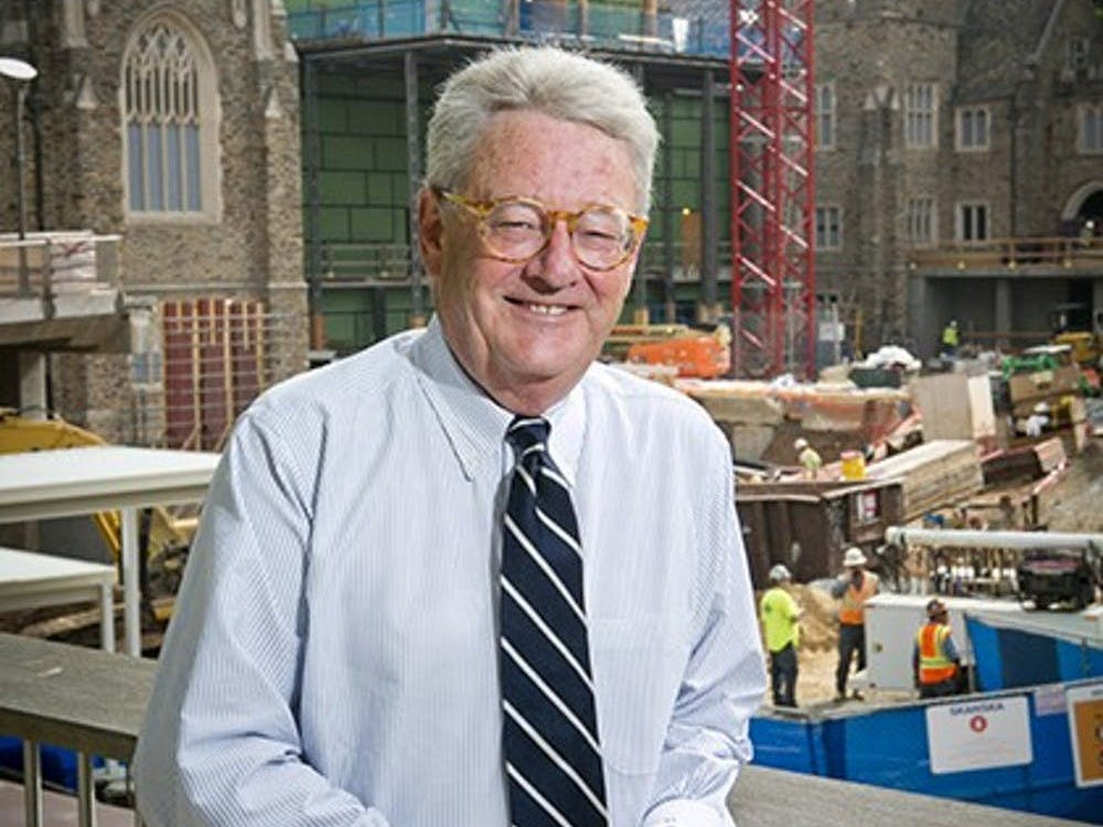 Trask standing in front of the renovation of the BC Plaza. Courtesy of Les Todd.