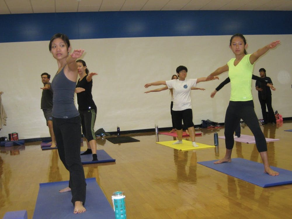 Yoga is a popular pastime for students trying to relax—many dedicated to the practice also teach classes at Wilson and Brodie Recreations Centers.
