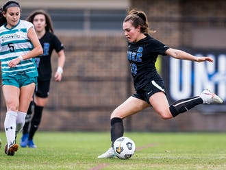 Olivia Migli's first career assist set up the winning goal for Tess Boade, allowing the Blue Devils to knock off their bitter rivals.