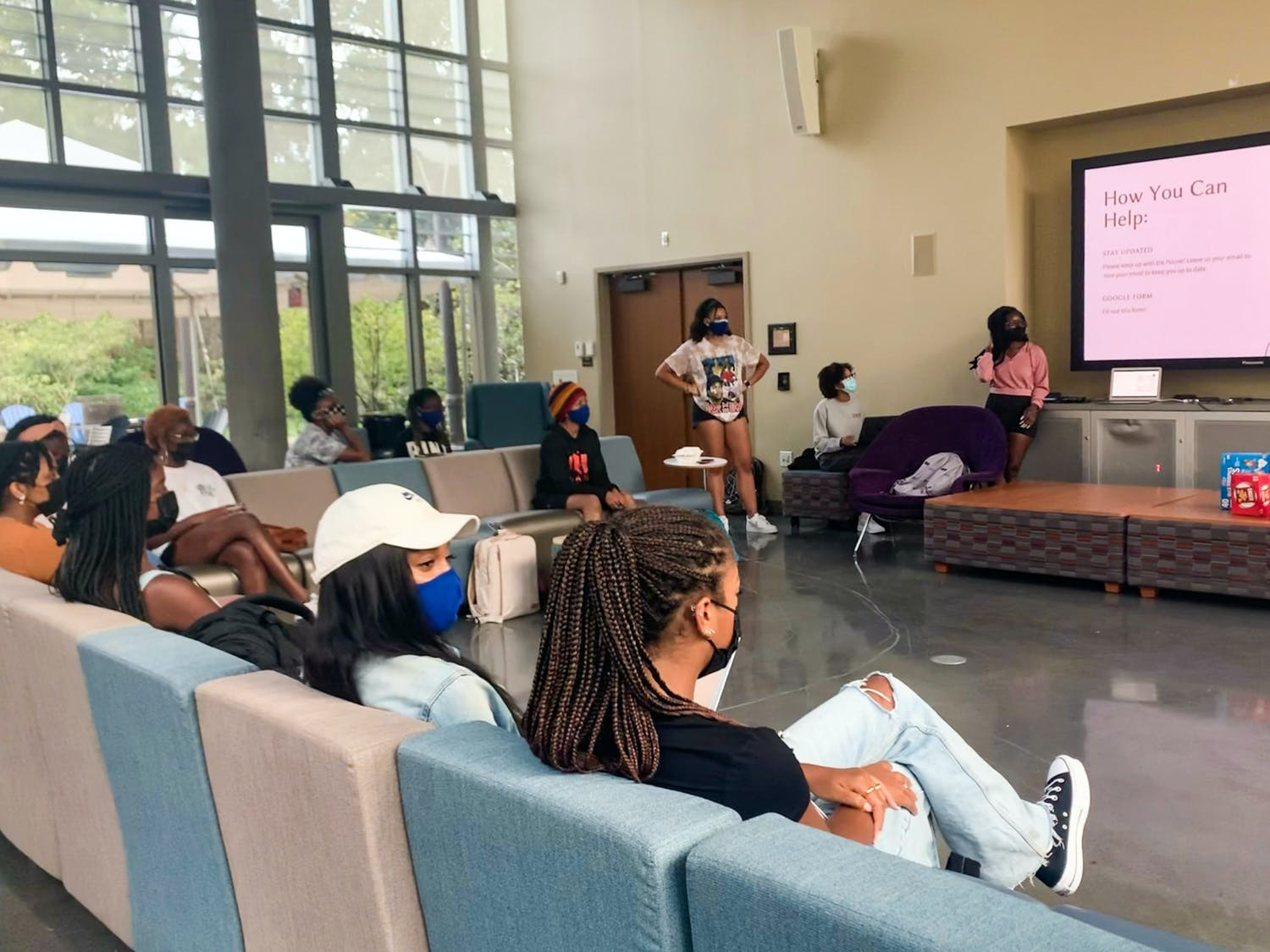 """At a recent event, student leaders of the Mitchell-White House gave a presentation that was broken into four sections: the history of MWH, what they were promised this year, what has been happening instead and a """"we want your ideas"""" slide to foster open discussion."""
