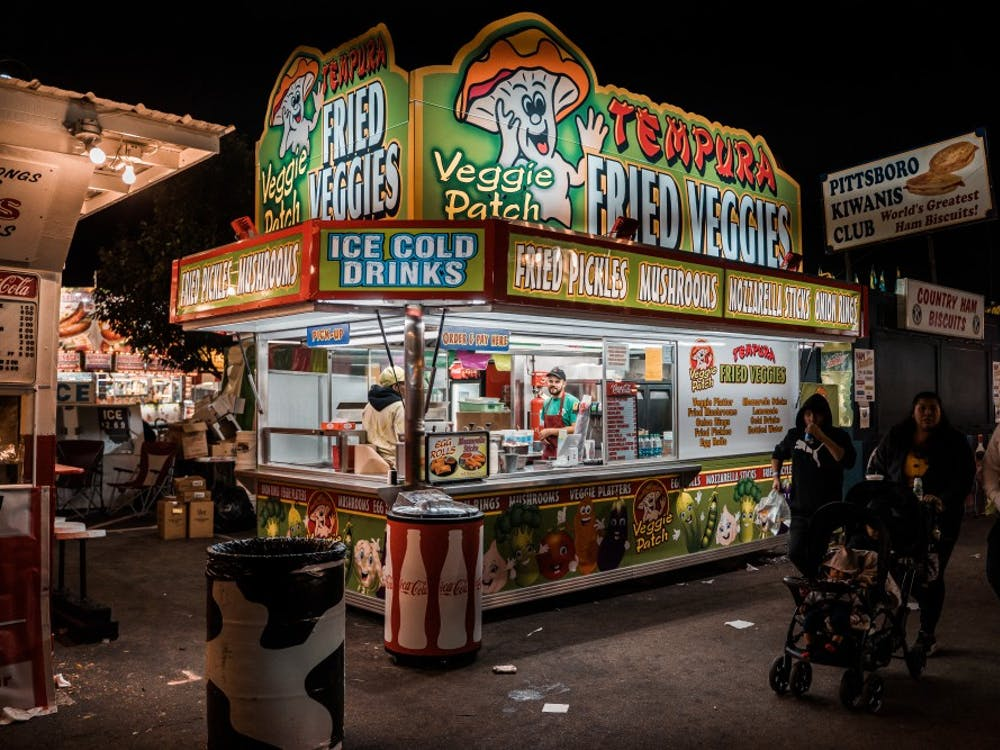 I'm in a state fair state of mind. Come revel in the fried food, fun games, and electrifying rides through Features Photography Editor, Aaron Zhao's best photos. The 2019 NC State Fair runs from October 17th to October 27th.