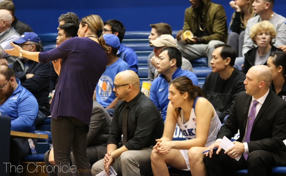 <p>Limin Xu sat behind the Duke bench and observed practices for three weeks in January.</p>