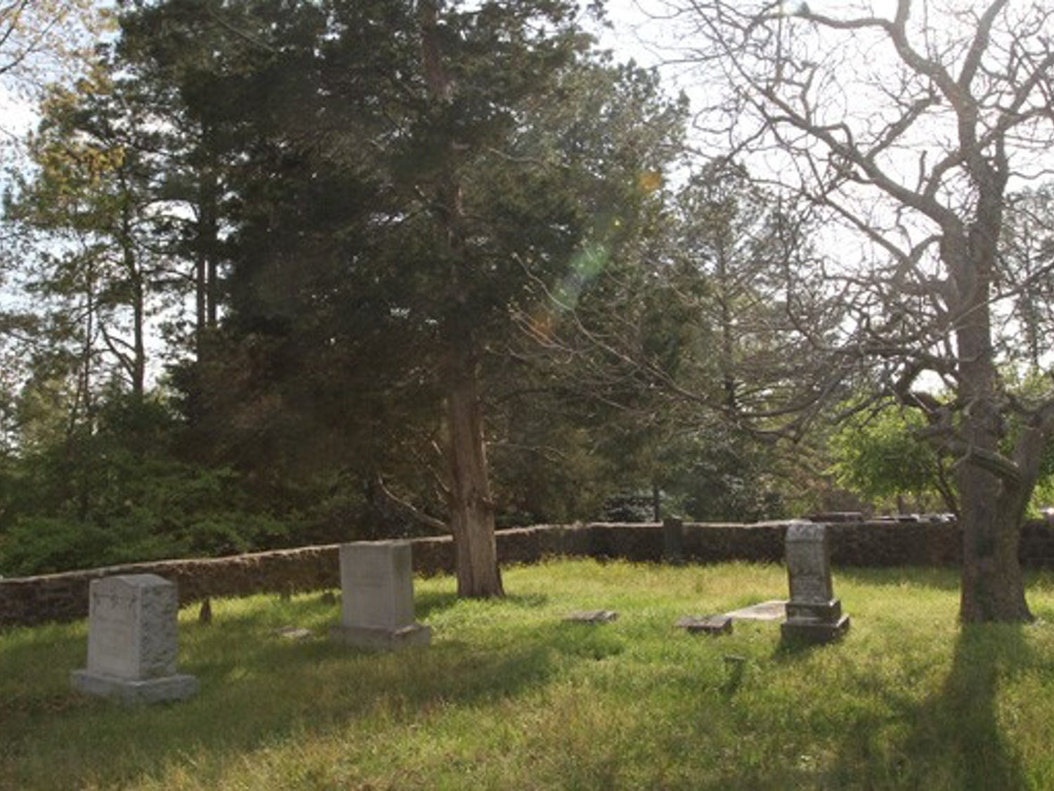 The TJ Rigsbee Family Grave Yard, located in the Blue Zone, serves as a reminder of the family who had owned land that would become West Campus.