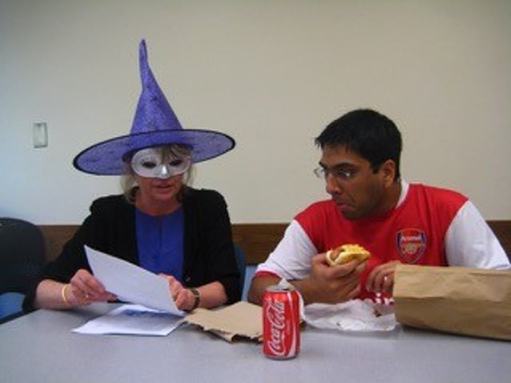 """<p>Melissa Malouf loved this photo """"because the student is so engaged despite [her] costume and his mouthful of food.""""&nbsp;</p>"""