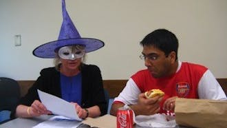 """Melissa Malouf loved this photo """"because the student is so engaged despite [her] costume and his mouthful of food."""""""