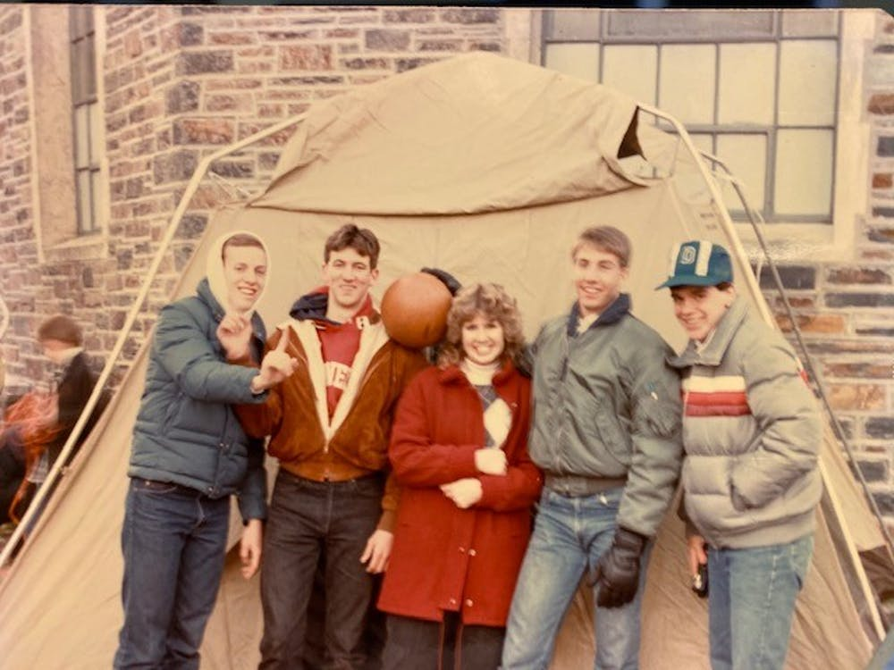 <p>Reed and friends pose in front of one of the original Krzyzewskiville tents prior to the home North Carolina matchup in 1986.</p>