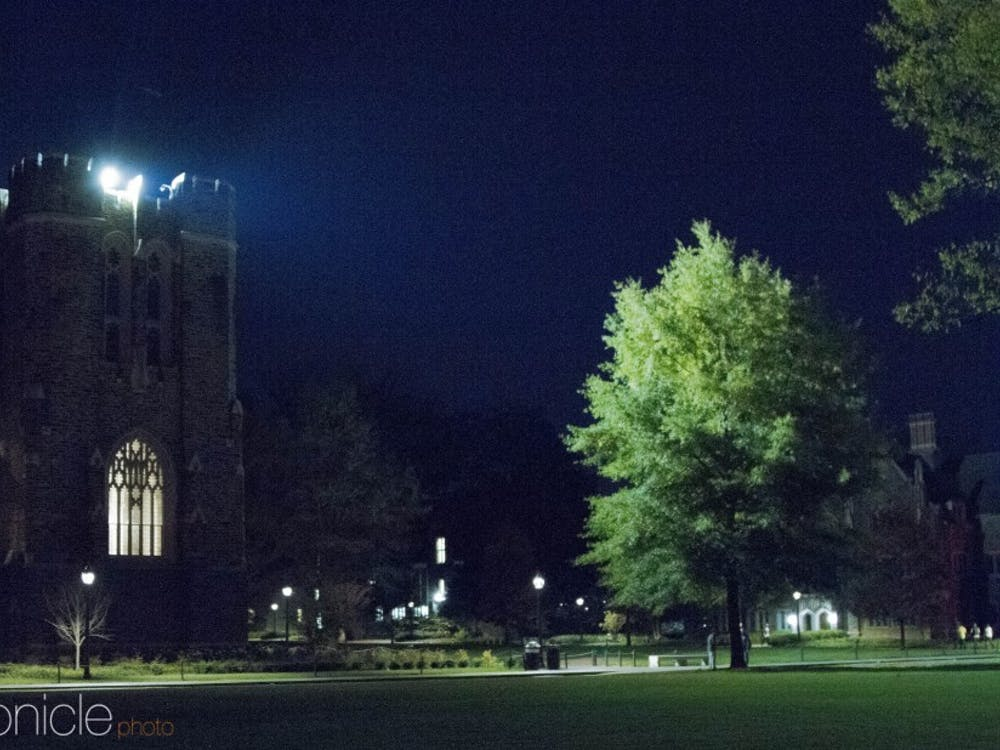 The spotlight on top of Rubenstein Library brightens Abele Quad.