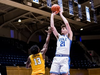 Despite sitting the last six minutes of the half with three fouls, Matthew Hurt helped the Blue Devils with eight first half points.