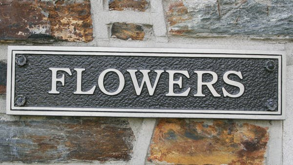 Closeup of the Flowers Street nameplate