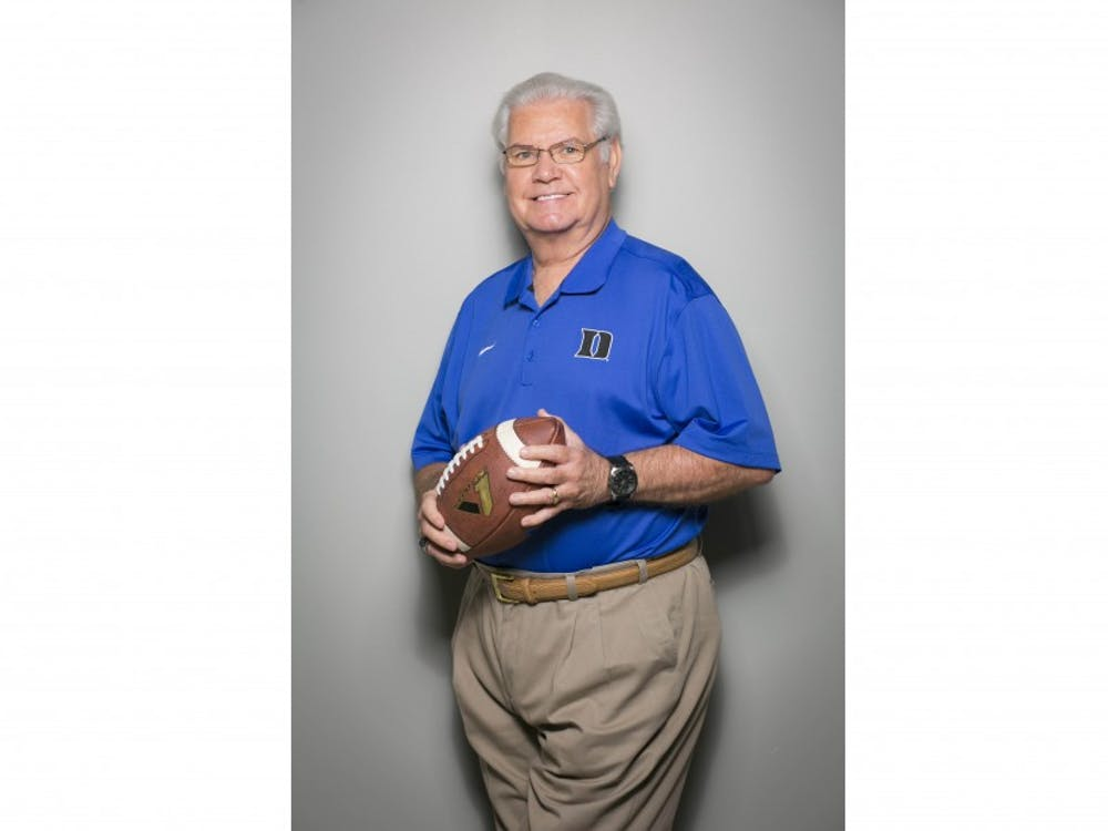 """Voice of the Blue Devils, Bob Harris, poses in the studio for a portrait.  Image will be used to highlight his years of service in the final year of doing """"play by play"""" for both the football and basketball programs."""