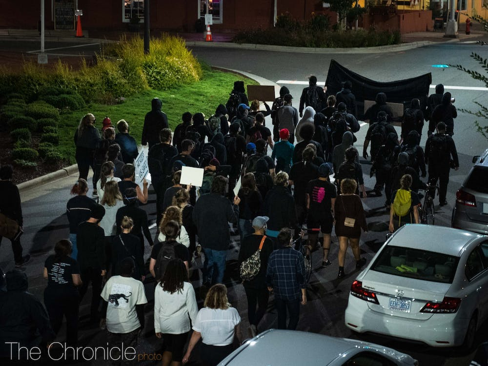 Protesters marching by Durham City Hall on Wednesday night.