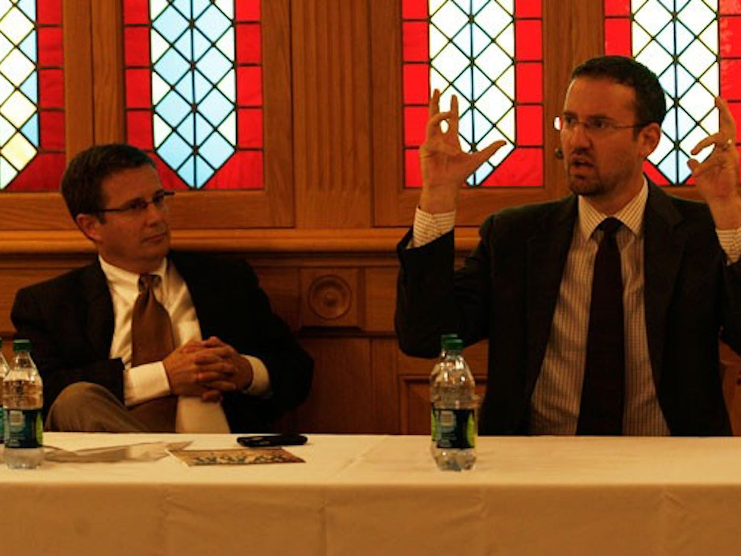 Moderator Peter Feaver and Will McCants, research analyst at the Center for Strategic Studies at CNA Analysis and Solutions, take part in a debate discussing the War on Terror in the Old Trinity Room Monday.