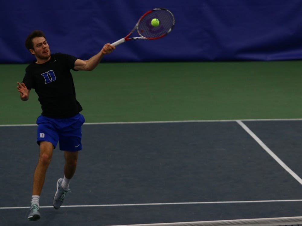 Senior Raphael Hemmeler notched Duke's only point Sunday against Virginia with an upset of No. 10 Thai-Son Kwiatkowski.