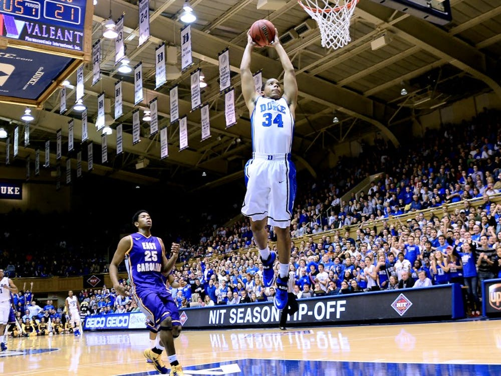 Graduate student Andre Dawkins, along with teammates Jabari Parker and Rodney Hood, gave the crowd at Cameron Indoor Stadium a healthy dose of slam dunks Tuesday.