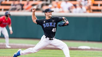 Graduate student Richard Brereton was one of three Blue Devil pitchers to take the mound in the first inning.