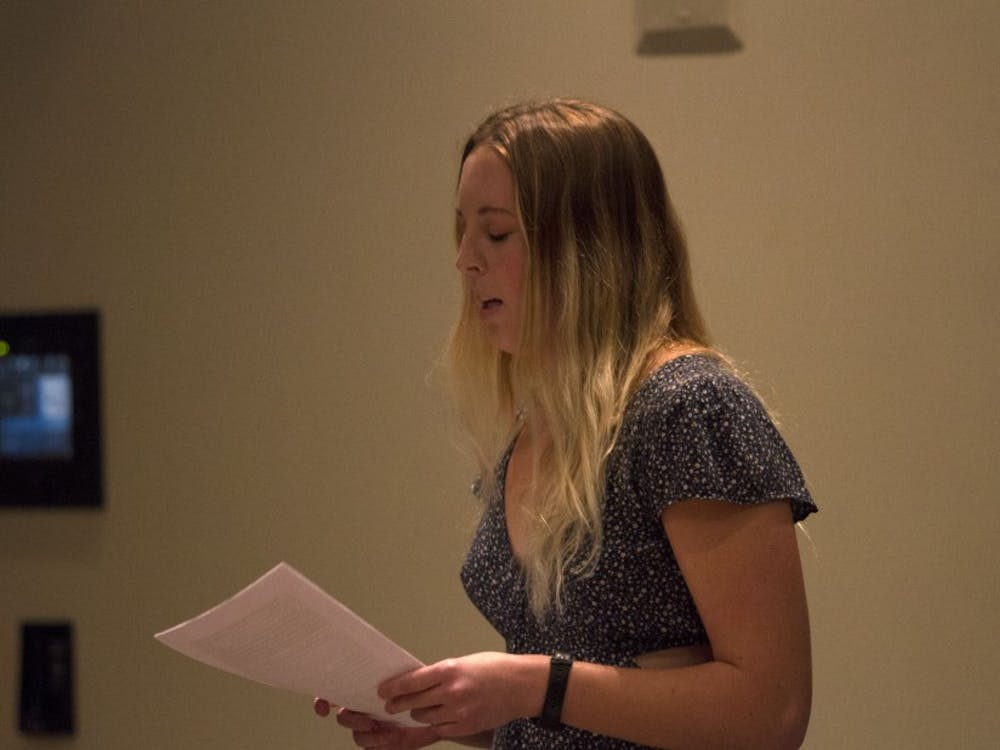 A writer reads her work at the Archive's 2017 Salon.