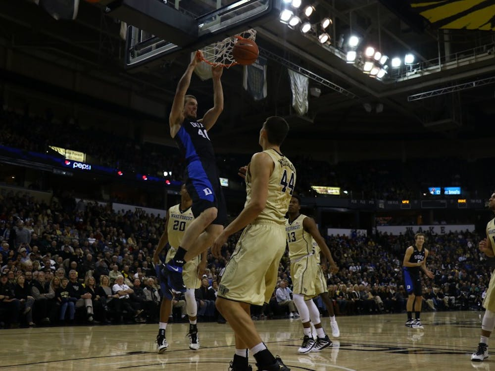 Center Marshall Plumlee dunked repeatedly in the second half en route to a career-best 18 points as the Blue Devils held off an upset-minded Wake Forest squad on the road Wednesday.