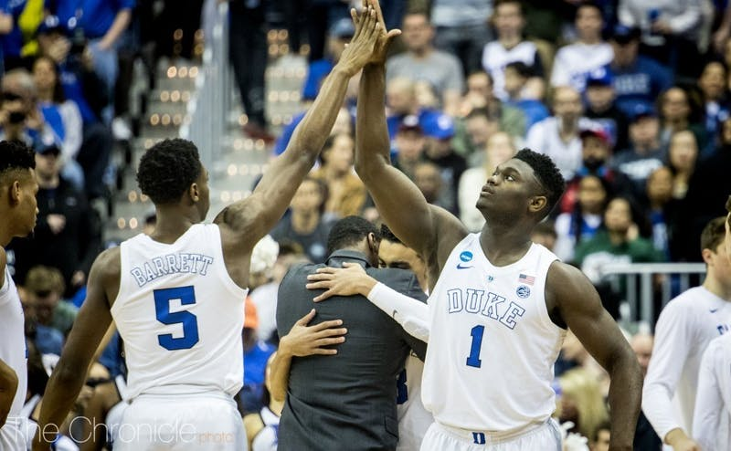 Zion Williamson and RJ Barrett will lace up for the first time as professional basketball players Friday night, this time on opposing benches.