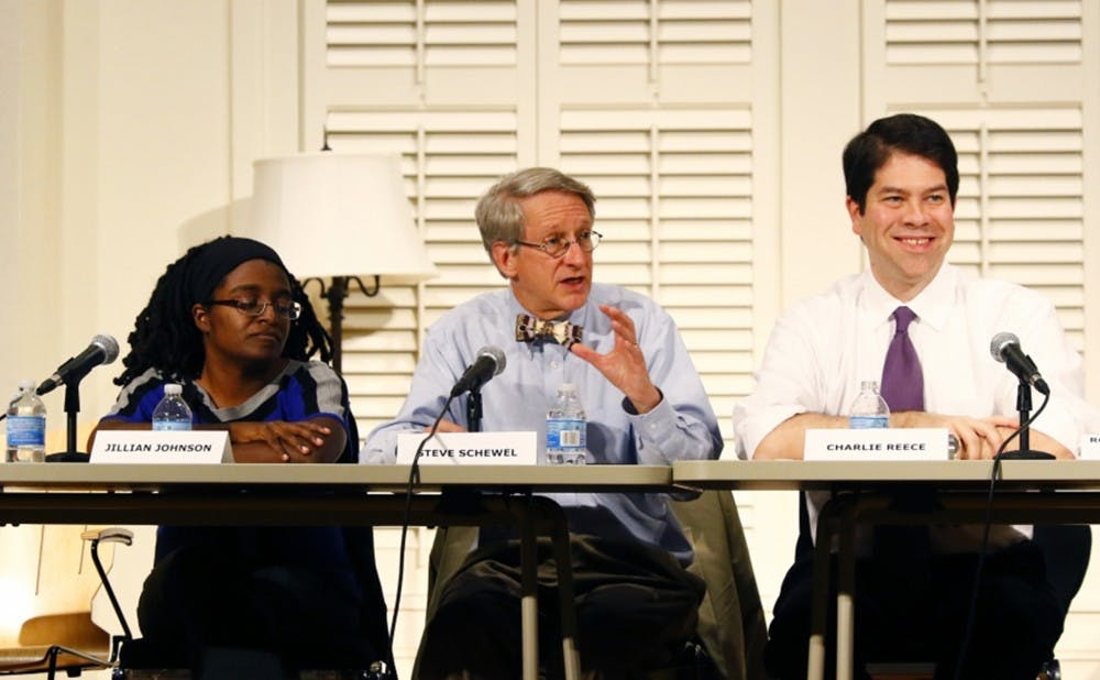 <p>Steve Schewel, city council member and visiting assistant professor in the Sanford School of Public Policy (middle), recently proposed a resolution that puts the city at odds with state leadership regarding the resettlement of Syrian refugees.</p>