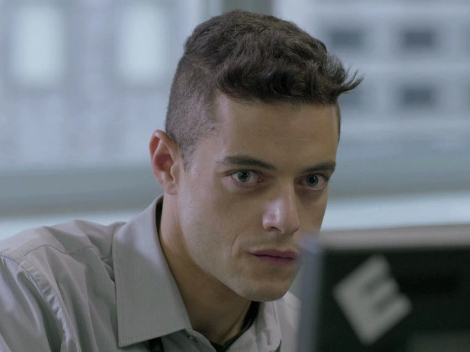 Elliot, played by Rami Malek, portrays an anti-hero set on overthrowing his cybersecurity firm.