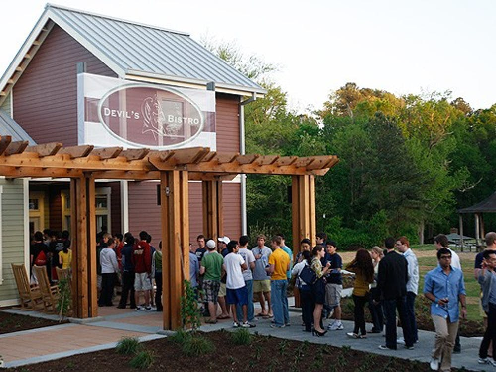"""Students line up outside the Devil's Bistro on Central Campus during Campus Council's """"Grand Central"""" party Friday evening.  The event celebrated the restaurant and Mill Village openings after months of delays."""