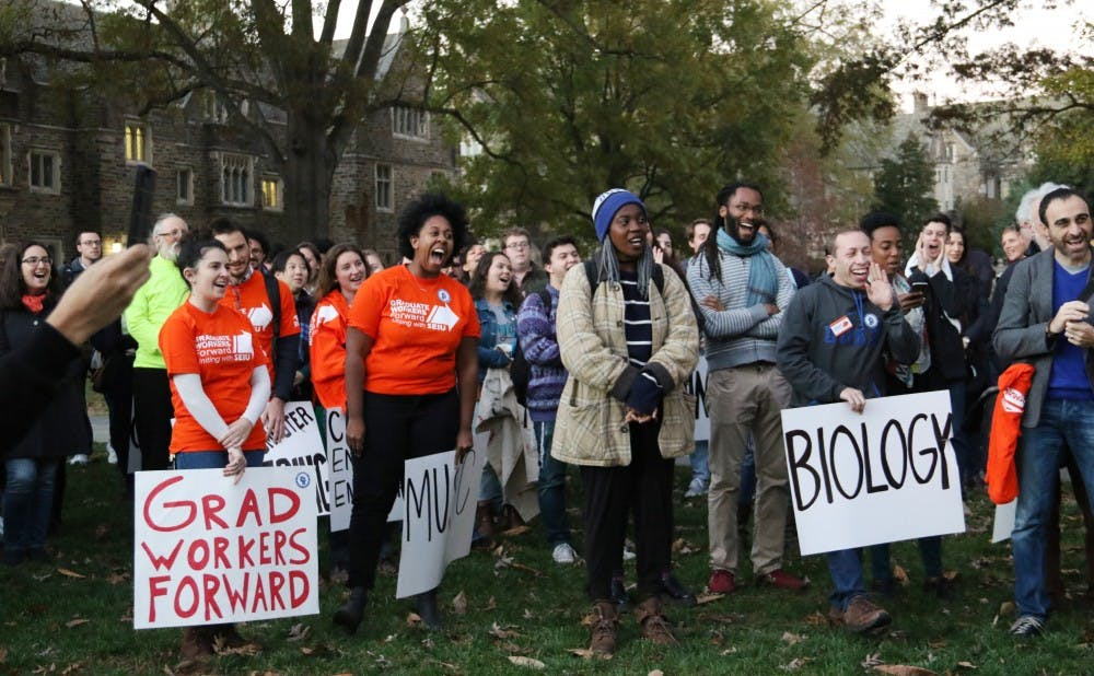 <p>Graduate students gathered in front of the Allen Building Thursday  to celebrate the officially submitting their unionization petition to the National Labor Relations Board.</p>