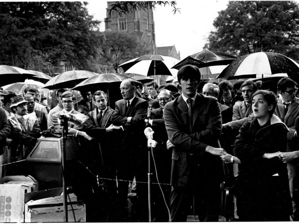 Students join hands on the quad during the Silent Vigil in 1968.   Courtesy of Duke University Archives.