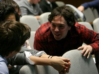 Junior Will Passo, vice president for Durham and regional affairs, solicits input on Young Trustee reforms from other attendees during Duke Student Government's special session Monday night.