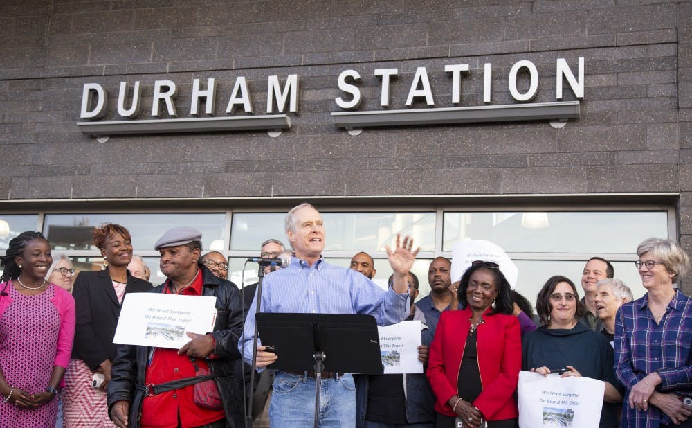 Community activists and elected officials gathered at the Durham Bus Station to urge Duke University to support the Durham-Orange County Light Rail.