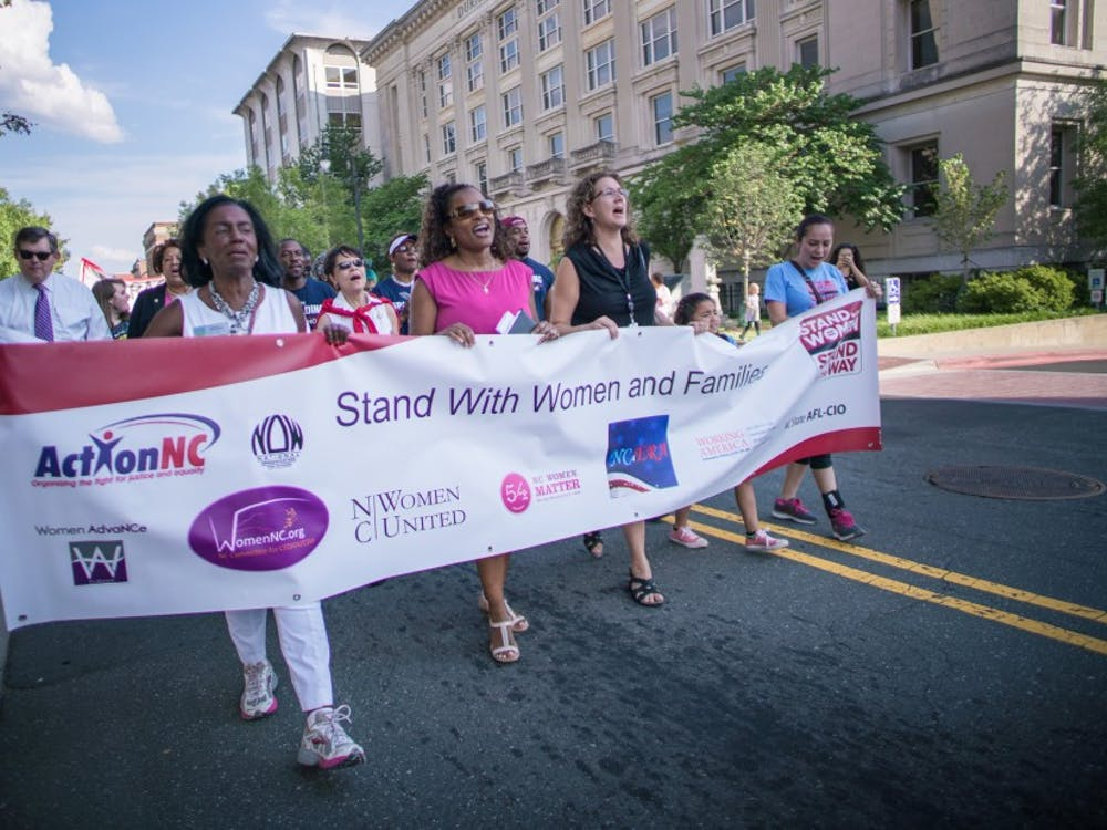 More than 300 people gathered in downtown Durham Friday afternoon to celebrate Women's Equality Day.