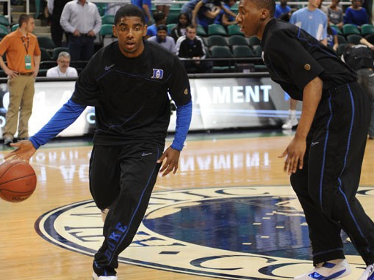 Kyrie Irving participated in warmups twice before ACC tournament games, exciting Duke fans in Greensboro.