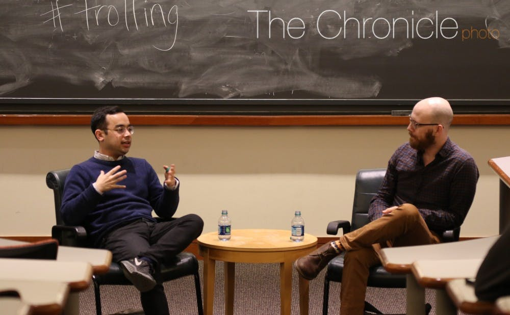 <p>Adrian Chen (left) examined&nbsp;a Russian trolling agency in 2015 for The New York Times Magazine.</p>