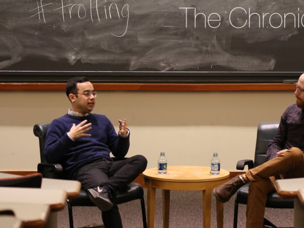 Adrian Chen (left) examineda Russian trolling agency in 2015 for The New York Times Magazine.
