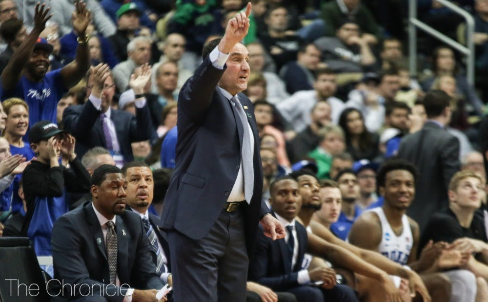 <p>Mike Krzyzewski passed Pat Summitt for the most career wins in Division I college basketball history Saturday.&nbsp;</p>