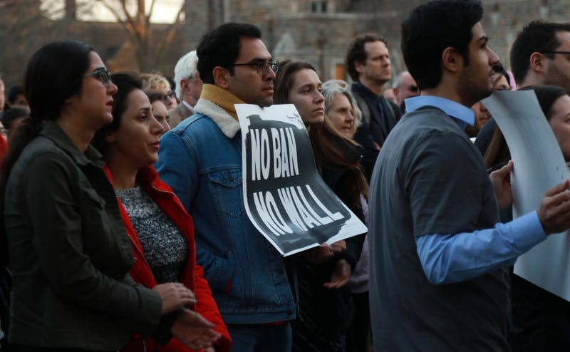 Members of the Duke and Durham community gathered at the Chapel Tuesday afternoon to protest President Donald Trump's executive order affecting immigrants and refugees.
