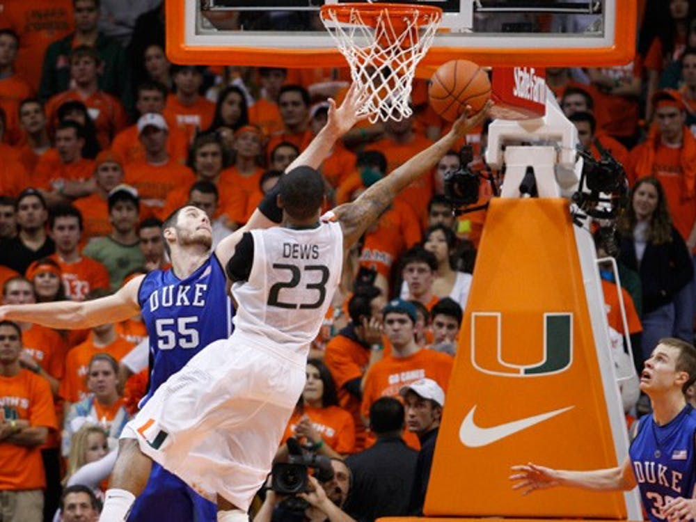 Senior Brian Zoubek goes up for a block against Miami's driving guard, James Dews, during Duke's seven-point escape at the BankUnited Center in Coral Gables, Fla.