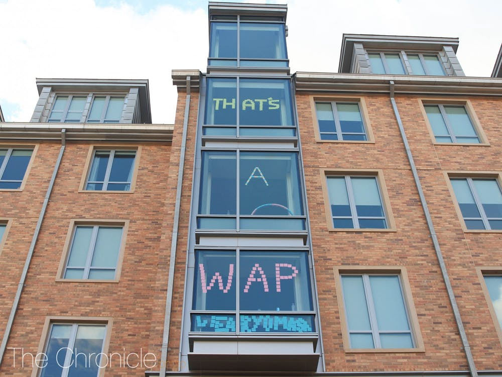 <p>Students in Hollows Quad have put up window signs during the pandemic, but Duke has rules in place regarding what students can display in their windows.</p>