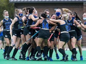 Hannah Miller was swallowed up by teammates after her game-winner against Louisville in April of last season.