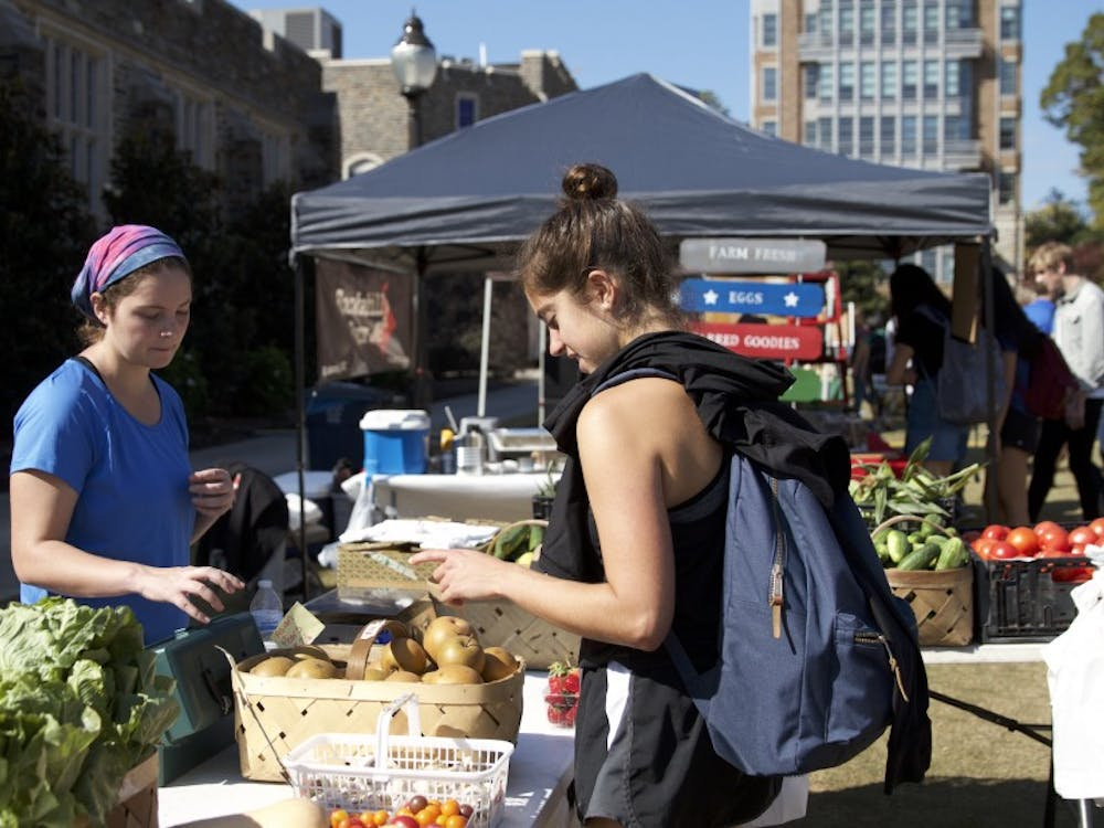 Students browse locally-sourced produce at Friday's K-Ville Farmers' Market, which was the culmination of months of collaboration.