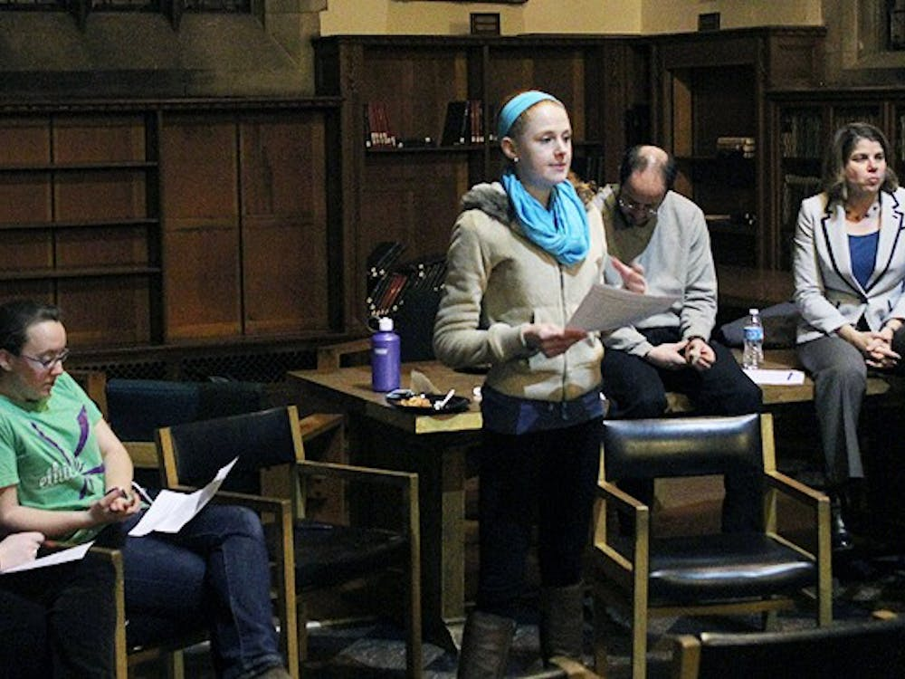 Freshman Gayle Powell, a member of Team Kenan, introduces a panel of administrators at a discussion about social groups' selection processes Thursday night.