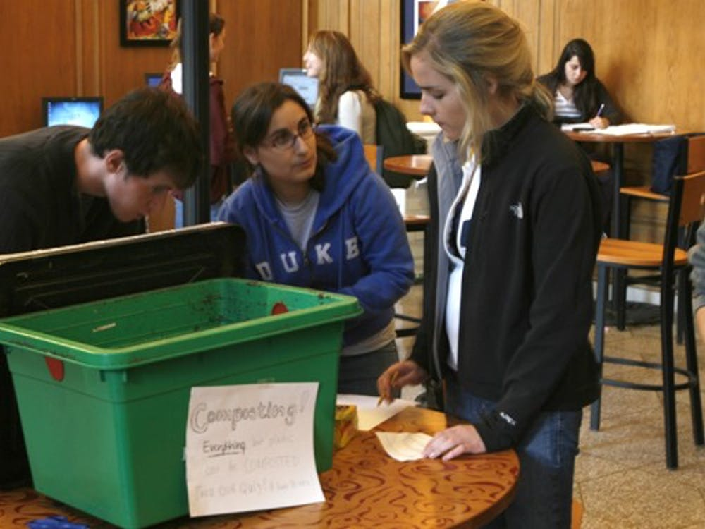 Freshmen partcipating in the annual Eco-Olympics learn how to compost leftover food at the Marketplace Monday afternoon. The competition aims to promote sustainable living among East Campus residents.