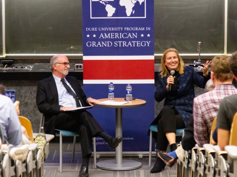 <p>Israeli Foreign Minister Tzipi Livni (right) at Wednesday's talk, moderated by Bruce Jentleson (left).</p>