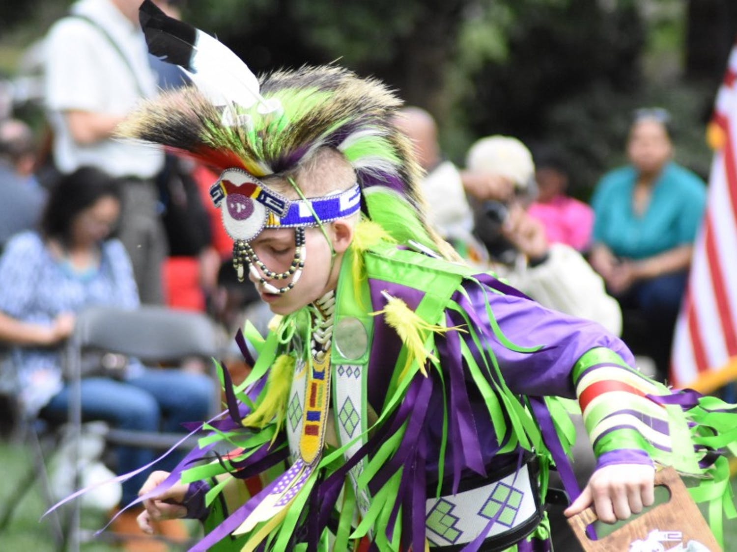 A dancer performs at Duke's annual powwow celebration, which took place on Abele Quad Saturday, April 14.