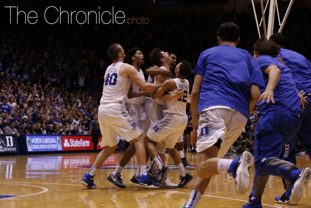 <p>The Blue Devils piled on Allen after his buzzer-beating runner, giving Duke its second straight win against a ranked opponent.</p>