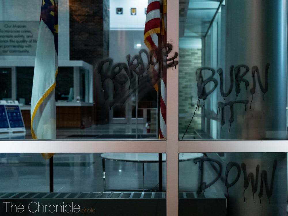 A window of the Durham Police Department headquarters left vandalized by protesters on Wednesday night.