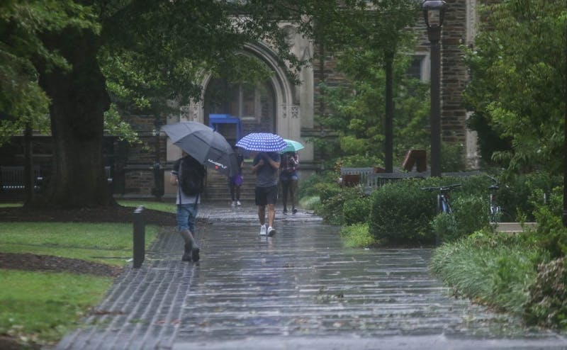 Students walking on Abele Quadrangle Friday afternoon.