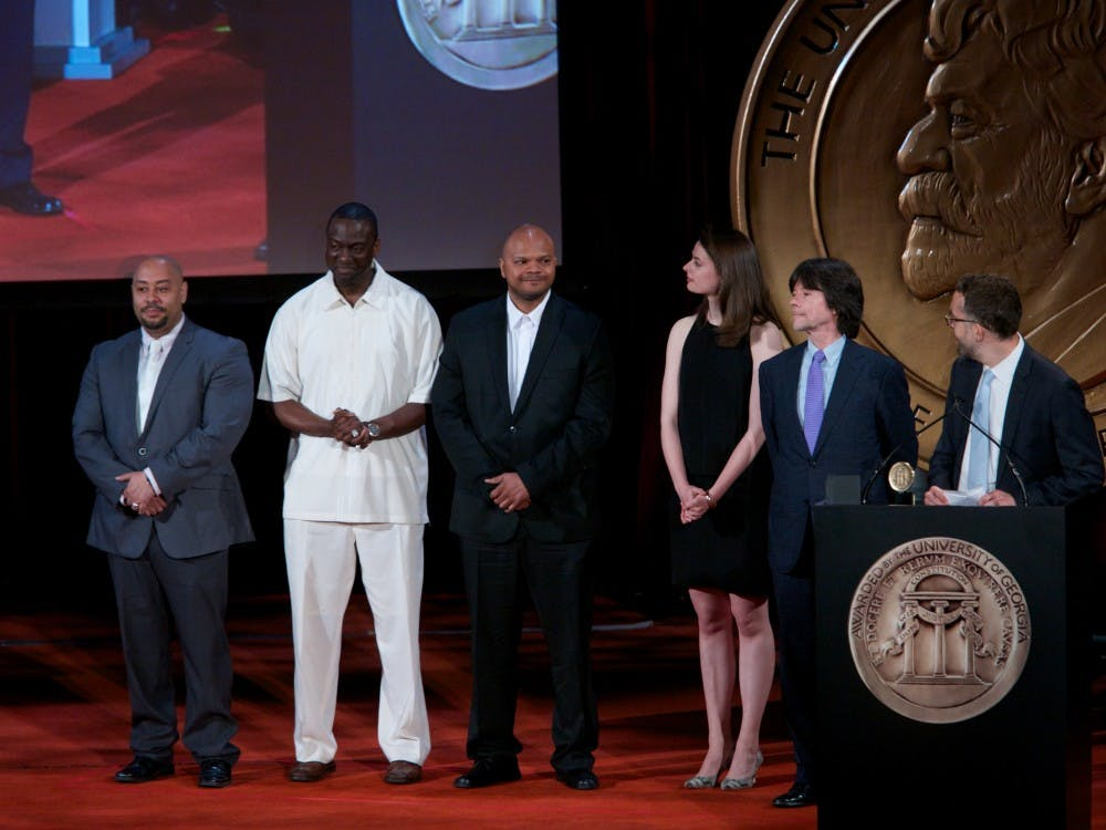<p>Members of the Exonerated Five with Ken Burns after the 2012 documentary about their case. Raymond Santana (left) and Yusef Salaam (second-from-left) are speaking at Duke next week.</p>